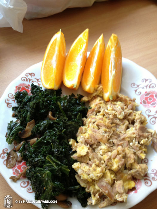 Scrambled eggs with tuna, kale and musrooms, orange slices.