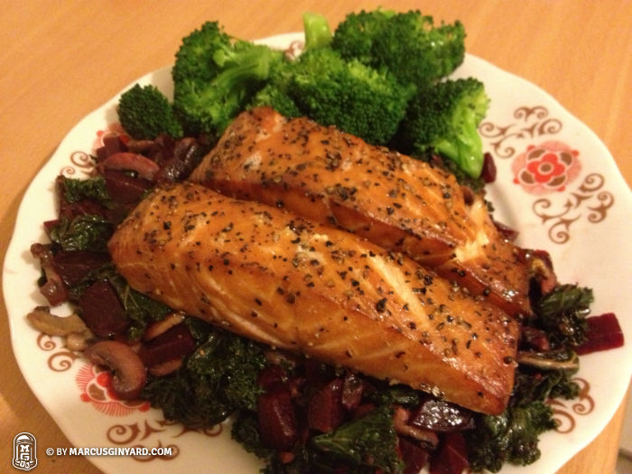 Kale and beets topped with two salmon filets, and broccoli.
